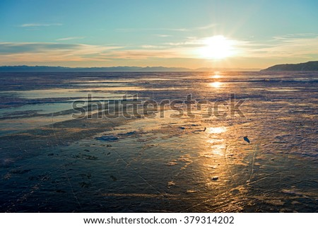 Frozen Baikal Lake on a sunset. Siberia, Russia - stock photo