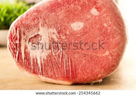 Frozen beef, veal. Piece eye of round - stock photo