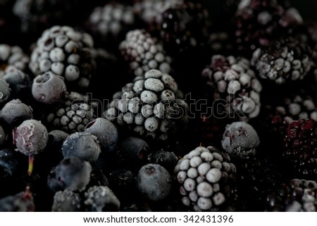 frozen blueberries and blackberries - stock photo