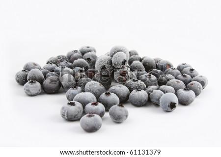 Frozen Blueberries on white background - stock photo