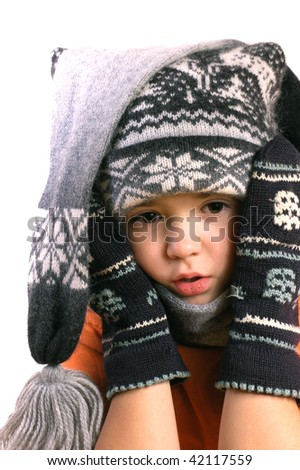 Frozen boy in the hat and mitts - stock photo