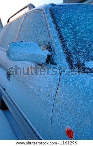 Frozen car - stock photo