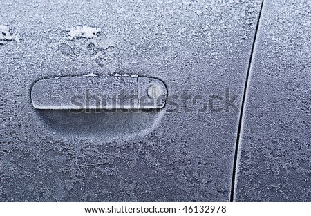Frozen car door closeup, ice crystals, jammed lock - stock photo