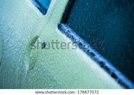 Frozen car door in winter - stock photo