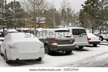 Frozen Car Snow Drifts on Outdoor Parking Lot - stock photo