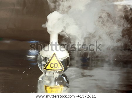 Frozen Carbon Dioxide, aka CO2 aka Dry Ice reacts violently when mixed with water, releasing CO2 into the enviroment