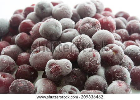 frozen cherries isolated on a white background close-up - stock photo
