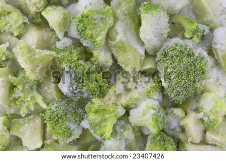 frozen diced green broccoli background with ice and frost - stock photo