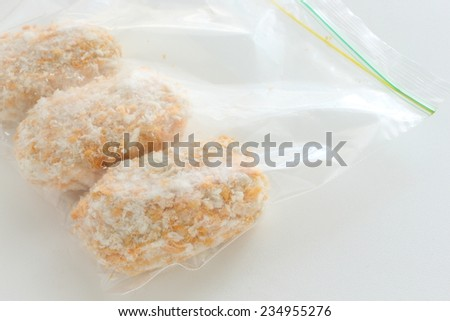 Frozen food, Bechamel croquette in plastic bag for stock image - stock photo