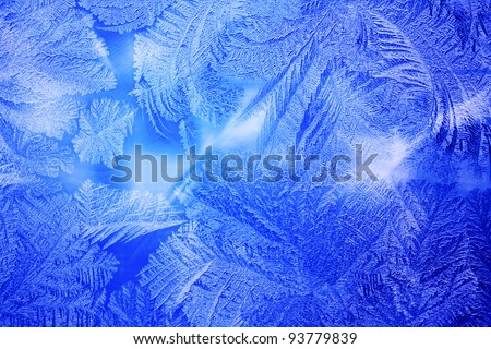 Frozen frost at a winter window glass - stock photo