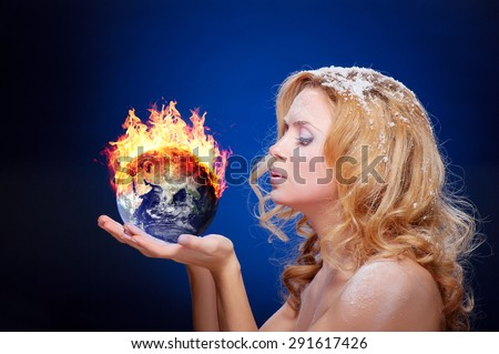 Frozen girl holding burning earth globe (east hemisphere) in palms (elements furnished by NASA) - version without glowing - stock photo