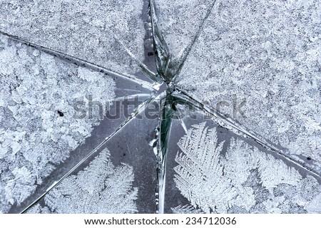 Frozen glass broken window. - stock photo