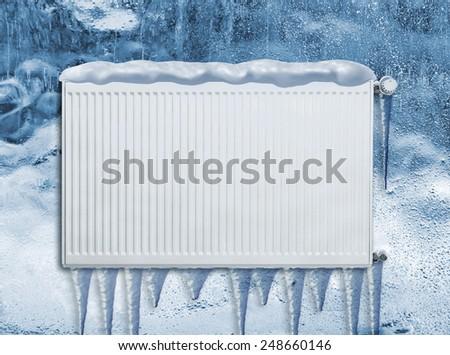 Frozen heating radiator - stock photo