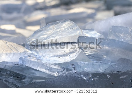 frozen ice surface of a lake in sunset - stock photo