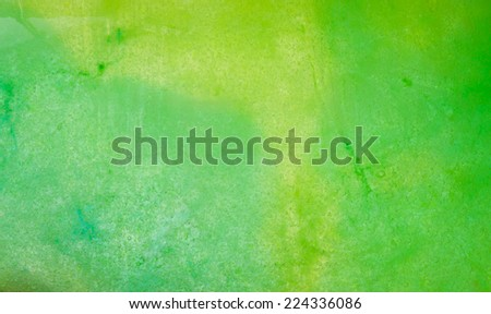 Frozen ice texture made from water colored in green and yellow colors - stock photo