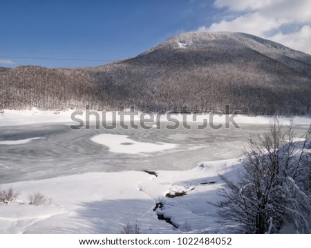 Frozen lake, Lagastrello pass in the Apennine mountains, Italy. Winter 2018.
