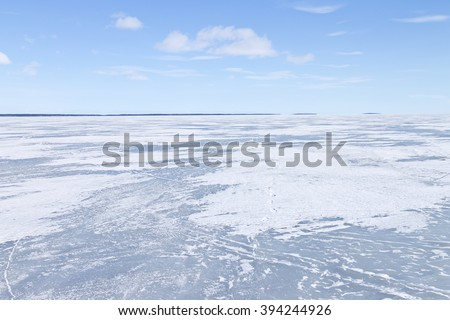 Frozen lake on a clear winter day - stock photo