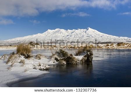 Frozen lake with Mount Ruapehu, Tongariro National Park, Manawatu-Wanganui, New Zealand - stock photo