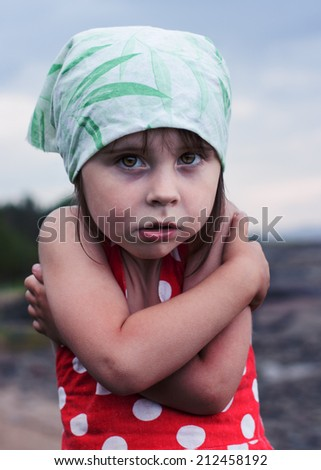 Frozen little girl in a stressful condition. - stock photo