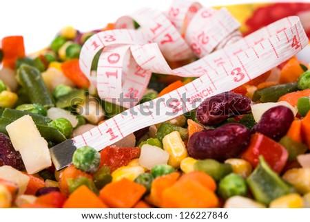 Frozen mixed vegetables on white background - stock photo