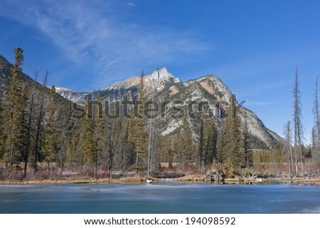 Frozen Mount Lorette Pond, Elbow-Sheep Wildland Provincial Park, Kananaskis Country, Alberta, Canada - stock photo
