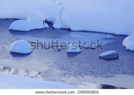 Frozen mountain river, with snow and ice. - stock photo