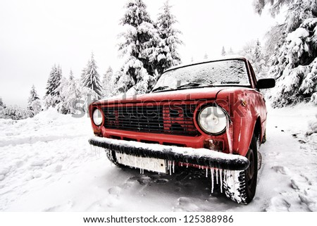 Frozen old Russian car in the winter - stock photo
