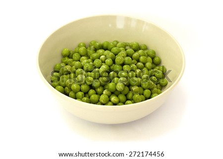 frozen peas in a bowl on a white background - stock photo