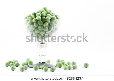 Frozen peas in small glass