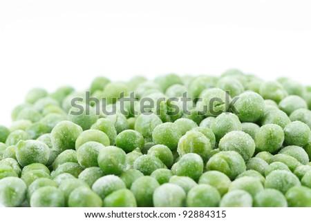 Frozen peas on white background - stock photo