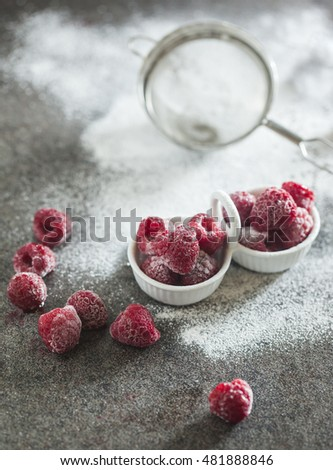 Frozen raspberry with sour cream on the table