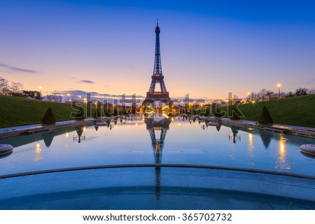 Frozen reflections in Paris. Eiffel Tower at sunrise from Trocadero Fountains  - stock photo