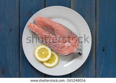 frozen salmon with lemon - stock photo