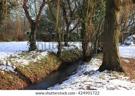 Frozen stream snow landscape on a very cold winter day - stock photo