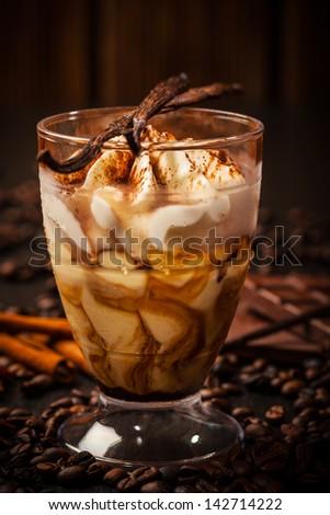 Frozen tiramisu dessert with ingredients - stock photo