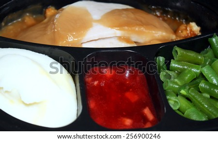 Frozen Turkey Dinner which has been heated and is now ready to eat - stock photo