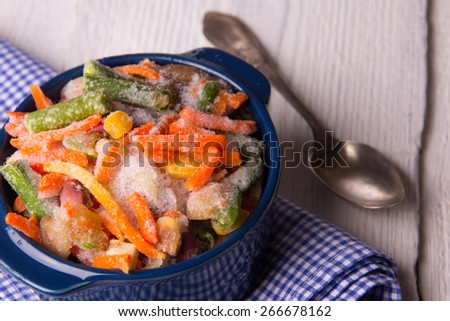 Frozen vegetables in a crockery before roasting - stock photo