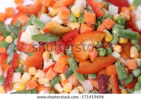 Frozen vegetables isolated on white in studio - stock photo