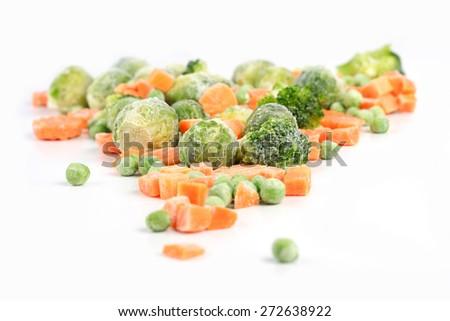 Frozen vegetables on white background - stock photo