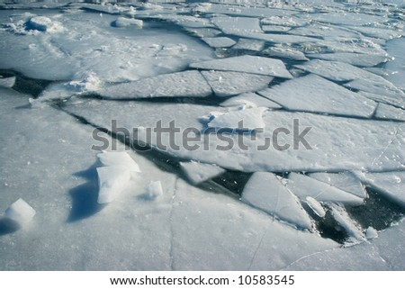 Frozen water surface with cracked ice