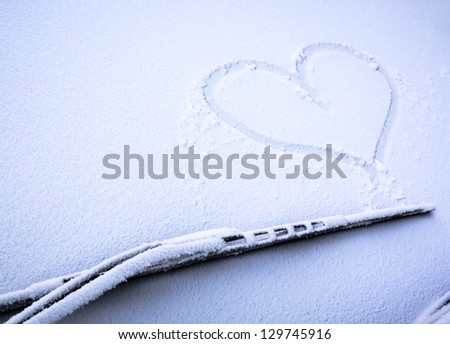 frozen windshield with heart - nice background - stock photo