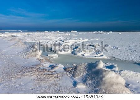 Frozen winter Baltic sea under snow during sunny day (Estonia) - stock photo