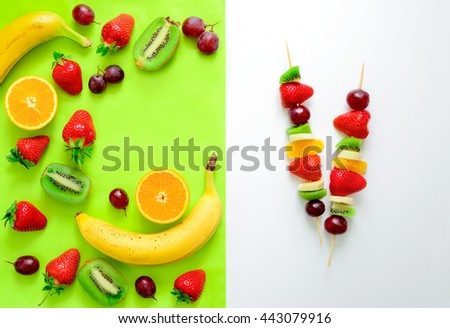 Fruit and berry skewers concept, simple healthy raw meal and ingredients, top view - stock photo