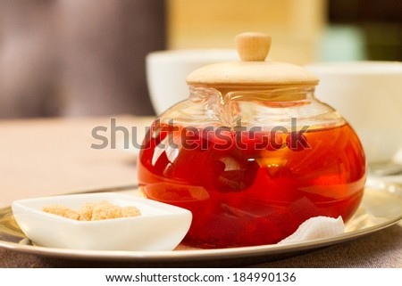 fruit and berry tea in a teapot - stock photo