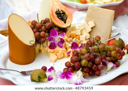 fruit and cheese platter with grapes at a wedding reception - stock photo