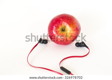 fruit and earphone on white background , music concept