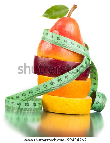 Fruit and measurement on a white background. A figure. A food. - stock photo
