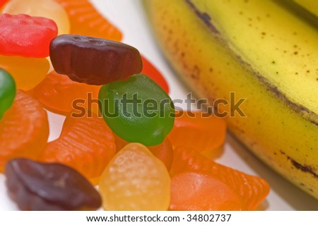 Fruit and multi-vitamins are a healthy supplement to children - stock photo