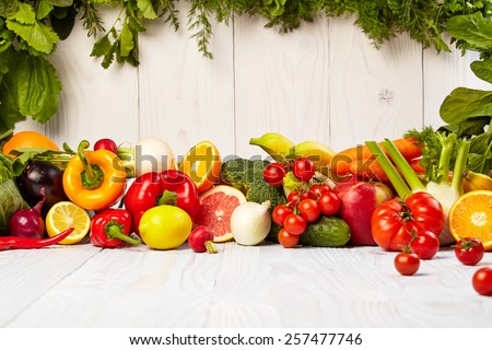 Fruit and vegetable borders Fruit and vegetable borders on wood table - stock photo