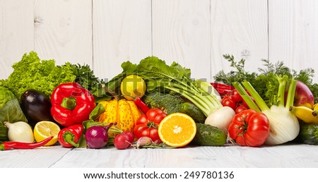 Fruit and vegetable borders on white wooden old table - stock photo